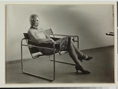 Lis Beyer or Ise Gropius sitting on the B3 club chair by Marcel Breuer and wearing a mask by Oskar Schlemmer and dress fabric by Beyer, c.1927. Herzogenrath, Berlin. © Estate Erich Consemüller