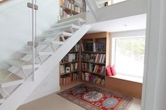 Turn the window under the staircase into a cozy reading nook with built-in bookshelves