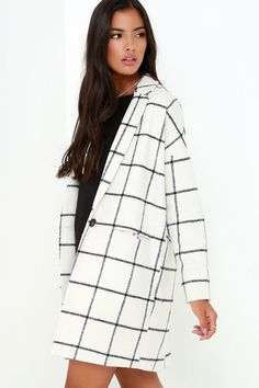 The City Streets Black and Ivory Grid Print Coat is sure to be a wardrobe staple piece through the seasons