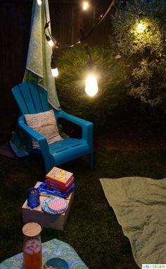 Need some tiny backyard ideas? Create a cozy extended outdoor area to help your family enjoy the longer summer days and nights! Outdoor Chairs, Outdoor Furniture, Outdoor Decor, Patio Lighting, Cozy, Backyard, Indoor, Lights, Reading