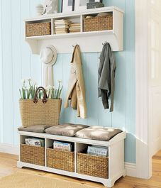 love the blue colour and the natureal earth and white tones they are a nice touch and the storage idea is a wonderful option for your entrance way