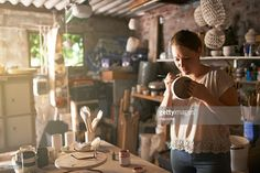 Cropped shot of a ceramic artist decorating a cup