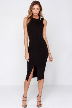 You'll get more than just fifteen minutes of fame when the One Fit Wonder Black Bodycon Midi Dress is worthy of a roaring encore! Black stretch knit creates a clean presentation on a sleeveless bodice with a high, squared-off neck and wide double straps, with an ultra sexy bodycon fit. Darts add figure accentuating shape down to a midi length skirt with front slit. Exposed gold zipper at back. Front of bodice is lined. 66% Viscose, 303% Nylon, 5% Spandex. Dry Clean Only. Made With Love in…