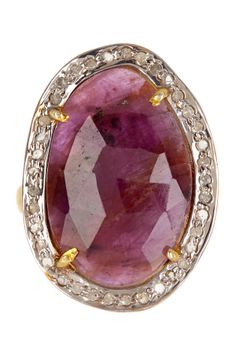 Organic ruby sapphire with some cuts.  Super interesting design that looks freeform in the diamond placement.  Would make a bold choice for an engagement ring.