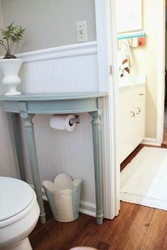 Add a half table over a toilet paper holder to save space in a small bathroom and 32 other home upgrades and space savers Home Upgrades, Half Table, Sweet Home, Diy Casa, Small Bathroom Storage, Small Bathrooms, Bathroom Shelves, Bathroom Styling, Diy Storage