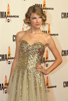 Taylor Swift sparkling golden gown & golden pearls & glam pinned up ringlets