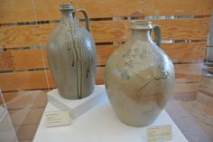"""Vernon Owens, 1983 (left), Travis Owens, 2012, decorated by Vernon Owens.  """"Old Ways in Mind.""""  The North Carolina Pottery Center, Seagrove, North Carolina."""