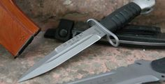 This bayonet is also included in the Ratnik program. It is made by a Russian company SARO (САРО). It was initially designed for AK-12 and reportedly is adopted along the previous bayonet.