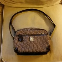 Alamode brown purse Classy brown purse. Has 1 larger pocket in front and 1 small on just right for a lipstick. The back has a small pocket as well. Inside is a zipper pocket as well. In perfect condition excepting one small scuff on the bottom. Alamode Bags Shoulder Bags