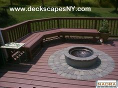 Deck idea with bench seating around a fire pit