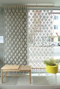 this macreme curtain would make a cool tablecloth on a picnic table outside.