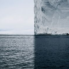 A Towering Iceberg and Its Shadow Split the World into Quadrants by Colossal  #Antarctica, #Art, #Ice, #Icebergs, #Landscapes, #Ocean, #Photography, #Shadows