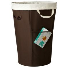 Room Essentials® Round Hamper - Brown - or maybe this one. Large coloring books are great but such a pain to store.