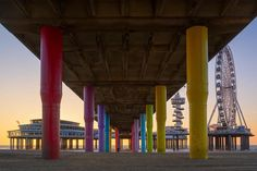 Rainbow Pillars  A classic shot of the Pier in Scheveningen.I love how they have painted al the pillars into rainbow colors. it makes for such a nice sight underneath the pier. And what do you do when there are no clouds and the sky is boring? Block the sky in this case with a pier! Another image from my visit to the awesome city of #scheveningen  (c)2017 martijnvandernat.nl all rights reserved . . @foto_konijnenberg @cameranu_nl @nikonnl @nikoneurope @nikontop_ @nikonearth_  @tokinausa…