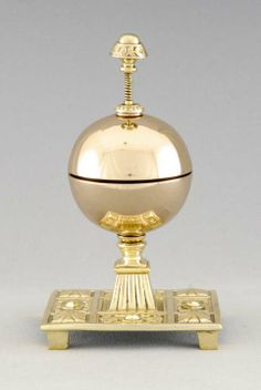 English antique double strike plunger style hotel bell in cast brass and bronze on ornate platform base, circa 1880.