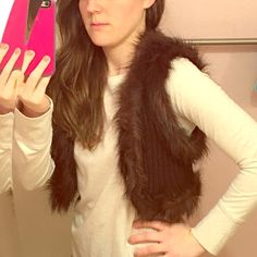Faux fur vest NWT faux fur vest. Size M but fits like a small. Has a clasp to hook the front of the vest, or can be worn open. Comfortable and easy to wear! Decree Jackets & Coats Vests