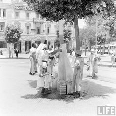 Egypt in the 1940s, life magazine - drinks vendors in the street with children, Cairo.