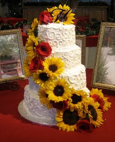 Sunflower Wedding Cake w/ red rose accents!  This would SO be my cake…but I might of had the piping done in red, and throw in a daisy or two with the flower..