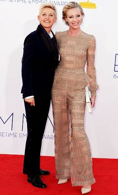 Ellen DeGeneres and Portia de Rossi arrived at the Emmys working monochromatic ensembles. DeGeneres wore a black suit with patent lace-up oxford wedges, while de Rossi chose a sheer nude jumpsuit with embroidered detailing and pumps in a similar shade.