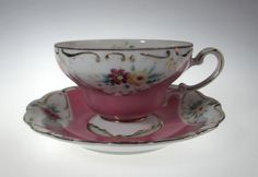 Very Nice, Hand Painted, Teacup and Saucer.  Pink on White Porcelain... with Gold Trim.  Flowers in Pink and Yellow  Marked, Merit ~ Made in