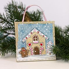 Create this project with Americana® Acrylics — Turn a plain canvas into a sweet gingerbread house ornament for your tree.