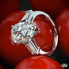 Forbidden Fruit    This 3.27 H SI2 Pear set in a Custom 14K White gold ring setting with 2 x 0.30ctw tapered baguette diamonds G/H VS2 6mm long 3.0mm wide taper to 2.50mm has us all razzled dazzled diamond sweet!!