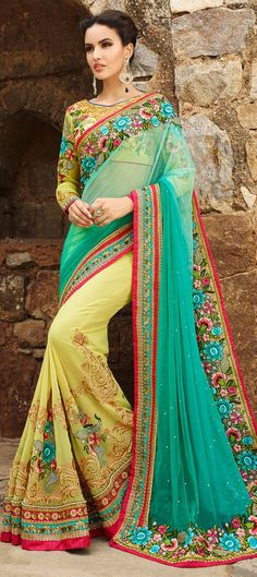180749: Green, Yellow color family Saree with matching unstitched blouse.
