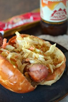 A German Bockwurst topped with quick and easy, healthy coleslaw and authentic German Spicy Mustard. This Bock n' Slaw Dog is a great griller!