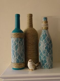 Lace, pearls, and twine adorn these rustic but lovely teal painted wine bottles. Made from recycled wine bottles, chalk painted in teal, and embellished with twine, pearls, and lace, these bottles will draw many an admiring glance. Set them on your fireplace mantle or a shelf, and make them a centerpiece on your table. The set will make a lovely housewarming or wedding gift too