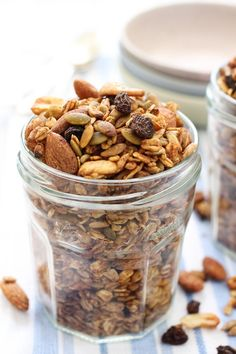 Homemade Sugar Free Granola Recipe. Made with healthy nuts, seeds, oats and olive oil. Naturally sweetened with apple sauce and raisins. No refined sugar added.
