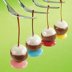 We've taken sweet maraschino cherries and dipped them twice in Wilton Candy Melts® candy. Serve them standing on a Candy Melts candy wafer for even more vibrant color!