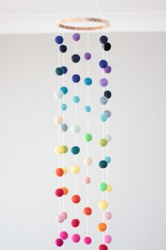 Rainbow felt ball baby mobile - bright, multicoloured baby nursery mobile by RocketnFloss on Etsy https://www.etsy.com/listing/222351166/rainbow-felt-ball-baby-mobile-bright // $60 // baby // nursery