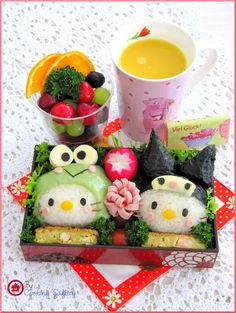 Bento!: I love creative bento lunches like this. And I really like how the Hello Kitties are dressed up like Keroppi and Kuromi.