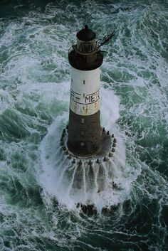 Ar Men Lighthouse, off Île de Sein, Brittany, France by Jean Guichard.