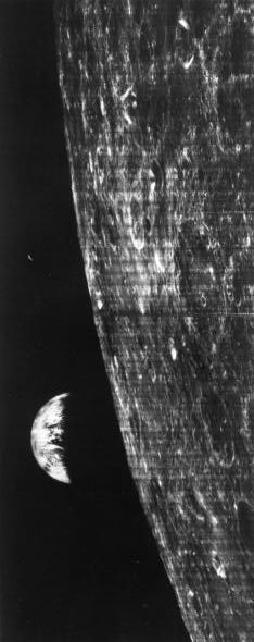 Lunar Orbiter 1 snagged the first glimpse of Earth ever taken from a spacecraft on August 23, 1966. The orbiter was on its 16th pass around the moon, seen here in the foreground.  Photograph by NASA