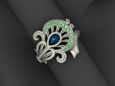 Peacock Feather Ring in Sterling Silver and Topaz.