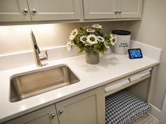 Check out this hip, dog friendly counter space featured in a contemporary, white laundry room only on HGTV. Hgtv, Room, Wellness Design, Household Chores, Hallway Pictures, Smart Home, Built In Dog Bed, White Countertops, Laundry Room
