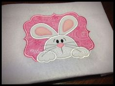 Adorable Easter Bunny appliqued hanging over a appliqued elegant border!    This design is 6.12 x 5.00 and approximately 9,813 stitches.    It