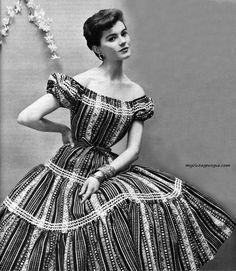 Model wearing a dress by Davids 1954