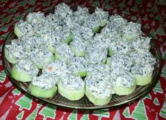 Cucumber slices topped Spinach dip! These are so good! I made them for a potluck and they were a hit! Cold Crunchy Creamy Yummy!!