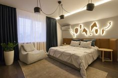 Bedroom Design Ideas - 8 Ways To Decorate The Wall Above Your Bed // Lighting - An empty wall above the bed is the perfect place to put a light fixture or two. They'll brighten up the room and can add a sculptural element to it, as well.