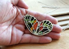 Real butterfly wing necklace - https://www.etsy.com/listing/220201481/real-butterfly-wing-necklace-real