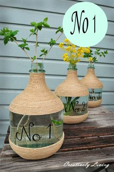 Create a statement using old wine jugs, jute and some paint ~ DIY Vase