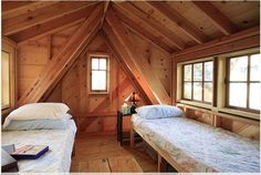 FOR THE TIGHT BUDGET:  The trap doors above a pull down ladder form the floor when closed. Build-in beds and a few tables make a place to camp out with the grand children.