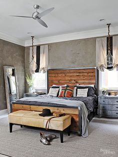 Industrial Edge - Handsome wood plank headboard with a metal frame. Cool grey bedding and accents set off the warm wood. From BHG.