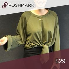 Olive / Army Green Tie Top Sweatshirt Polished cotton material, super comfy with a fit that is perfectly on trend: cropped length and full length bell sleeves. Fit works best for average to tall ladies. The sleeve length doesn't work for us petites! Boutique Tops Sweatshirts & Hoodies
