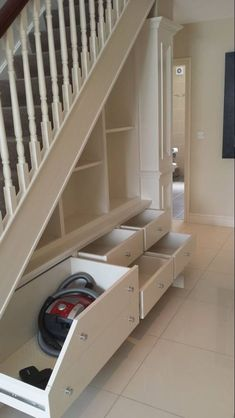 Something like this under the stairs. Easy access storage!