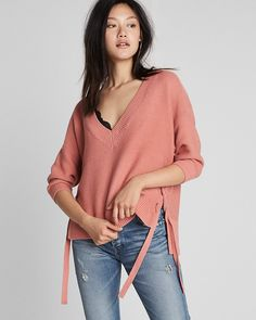 Trendy meets timeless in this sweater detailed with lace-up sides and a comfy shaker knit. It has an easy fit, solid hue and lighter weight, so you can easily take this one from cooler temps well into springtime. What are you waiting for?