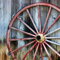 everyone needs an old wagon wheel to lean against the barn