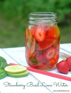 A refreshing strawberry basil lime infused water. A beautiful way to serve water to your guests and a delicious way to stay hydrated!